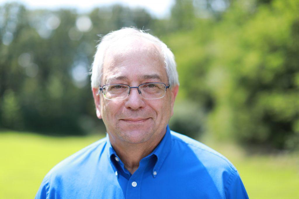 Jeff Gaynier standing in a field